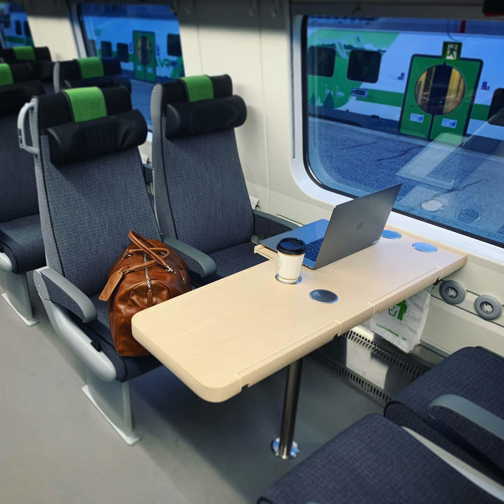 Photo from a train with a laptop on a table